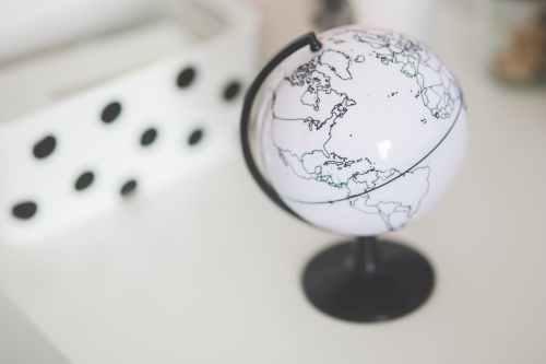 white globe on a desk