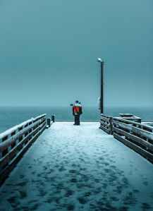 person standing on pier
