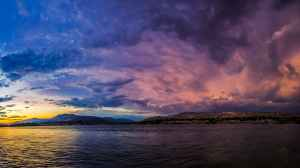 landscape photography of body of water under cloudy sky