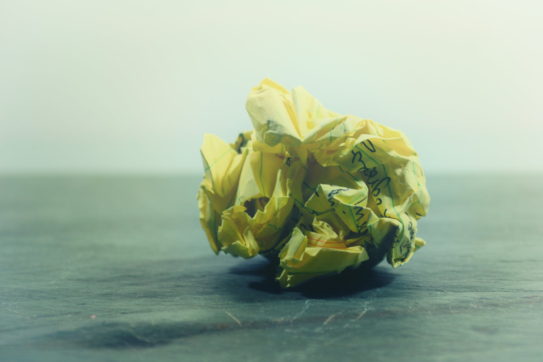 crumpled paper on gray surface