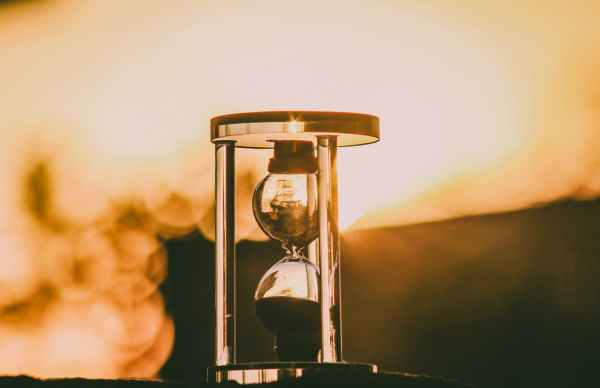 selective focus photography of hour glass