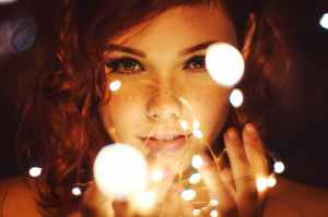 photography of a woman holding lights