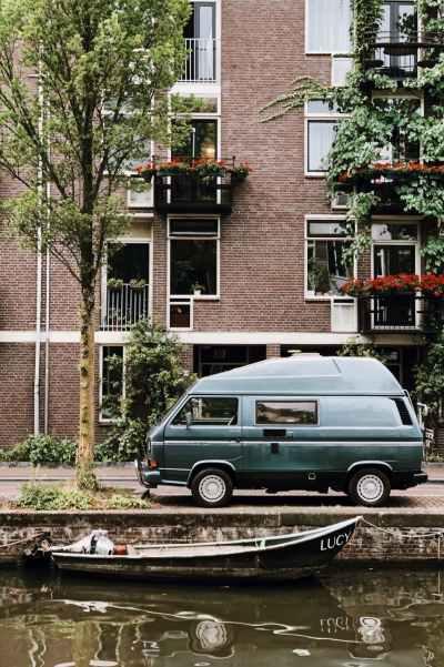 van parked in front of brown brick building