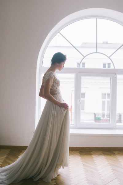 young woman near window in living hall